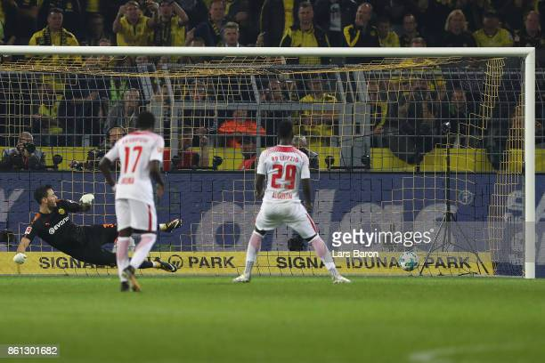 JeanKevin Augustin of Leipzig scores to make it 13 after Leipzig was awarded a penalty and Sokratis Papastathopoulos of Dortmund sent of with a red...