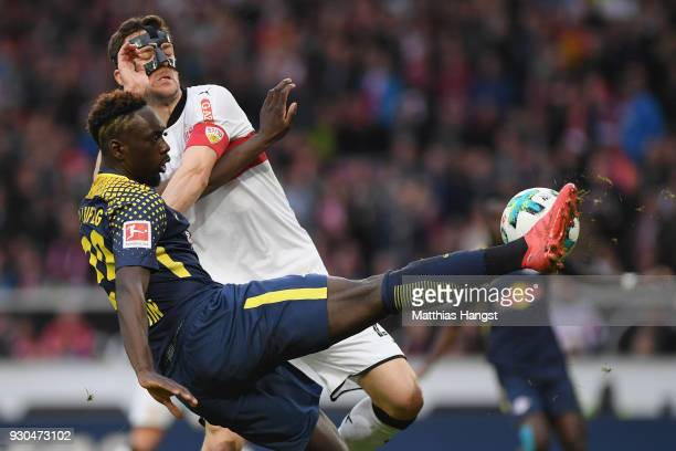 JeanKevin Augustin of Leipzig tries to score under pressure from Christian Gentner of Stuttgart during the Bundesliga match between VfB Stuttgart and...
