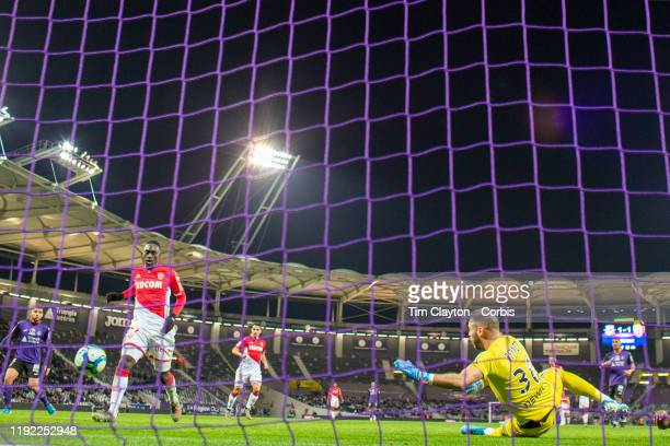 JeanKevin Augustin of Monaco beats goalkeeper Baptiste Reynet of Toulouse but the goal was ruled out for offside in the build play during the...