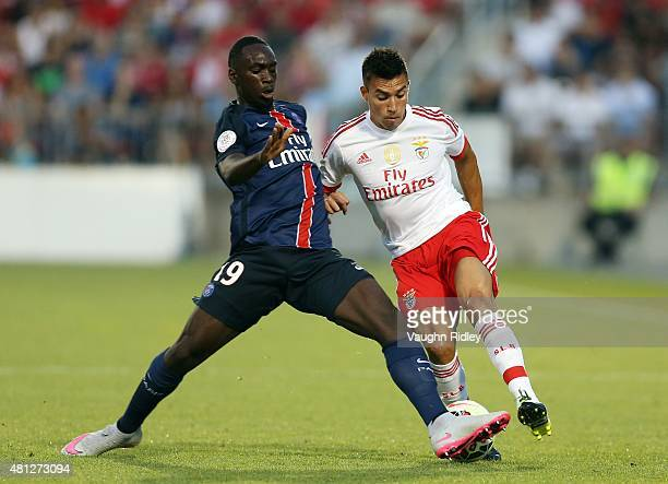 JeanKevin Augustin of Paris SaintGermain and Nico Gaitan of Benfica battle for the ball during the 2015 International Champions Cup match at BMO...