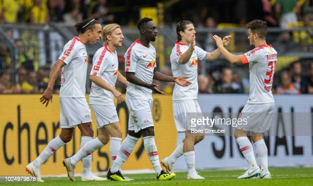 JeanKevin Augustin of RB Leipzig celebrates with team mates after scoring his team's first goal during the Bundesliga match between Borussia Dortmund...