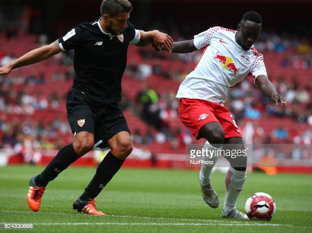 JeanKevin Augustin of RB Leipzig holds of Daniel Carrico of Sevilla FC during Emirates Cup match between RB Leipzig against Sevilla at Emirates...