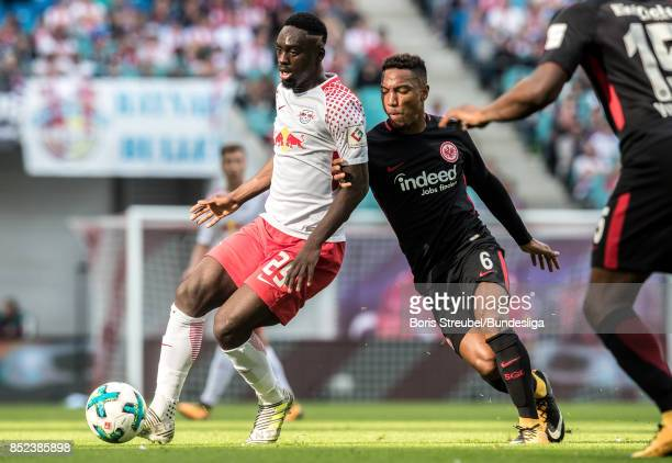 JeanKevin Augustin of RB Leipzig in action with Jonathan de Guzman of Eintracht Frankfurt during the Bundesliga match between RB Leipzig and...