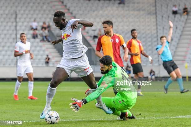 JeanKevin Augustin of Red Bull Leipzig goalkeeper Ismail Cipe of Galatasaray SK during the Preseason Friendly match between Red Bull Leipzig v...