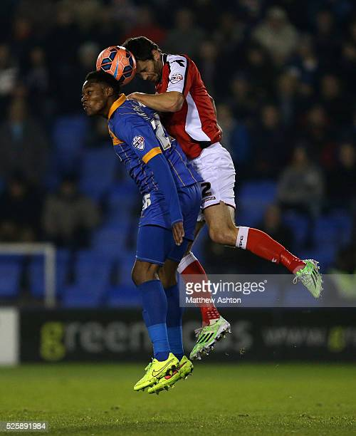 JeanLouis Akpa Akpro of Shrewsbury Town and Ben Purkiss of Walsall