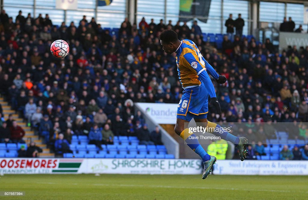 Jean-Louis Akpa Akpro of Shrewsbury Town heads to score his team's first goal during the Emirates FA Cup Fourth Round match between Shrewsbury Town and Sheffield Wednesday at Greenhous Meadow on January 30, 2016 in Shrewsbury, England.
