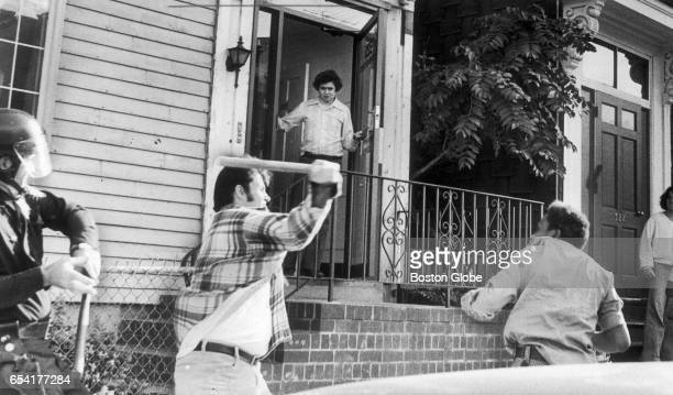 JeanLouis Andre Yvon right runs down Dorchester Street in South Boston being pursued by a man wielding a weapon on Oct 7 1974 Yvon was trying to...