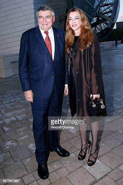 JeanLouis Beffa and Arabelle Reille Mahdavi attend the Foundation Louis Vuitton Opening at Foundation Louis Vuitton on October 20 2014 in...