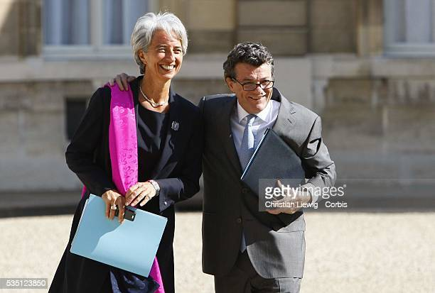 JeanLouis Borloo France's Minister of State Ecology Sustainable Development Town and Country Planning and Finance Minister Christine Lagarde arrive...