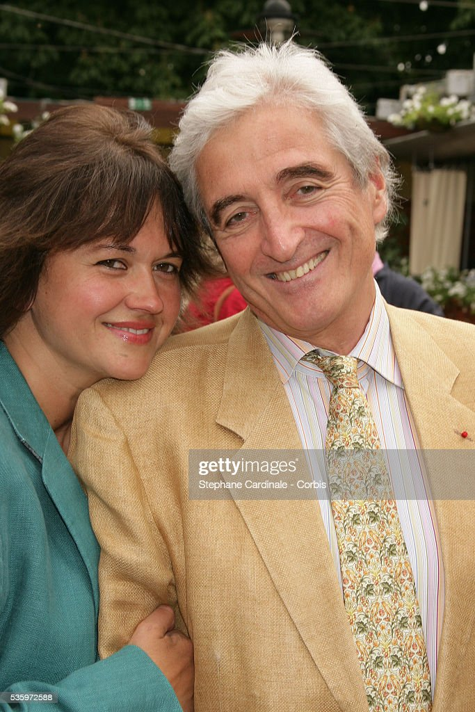 Jean-Loup Dabadie with his wife visit Roland Garros village during the 2005 French Open tennis.