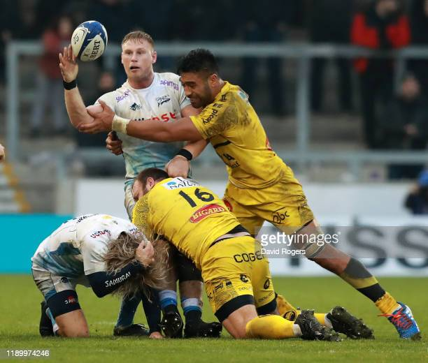 JeanLuc du Preez of Sale Sharks is tackled by Victor Vito during the Heineken Champions Cup Round 2 match between Sale Sharks and La Rochelle at AJ...