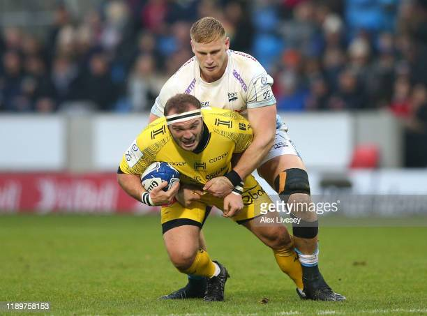 JeanLuc Du Preez of Sale Sharks tackles JeanCharles Orioli of La Rochelle during the Heineken Champions Cup Round 2 match between Sale Sharks and La...