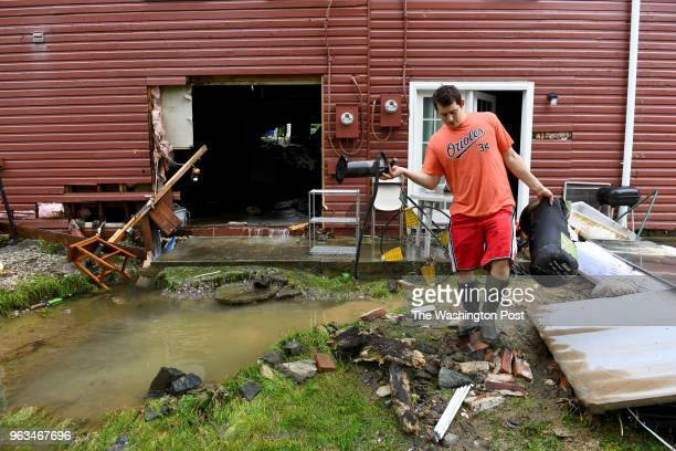 JeanLuc Durantaye begins to clean out his basement bedroom that flooded during the flash flooding that occurred the night before May 28 2018 in...