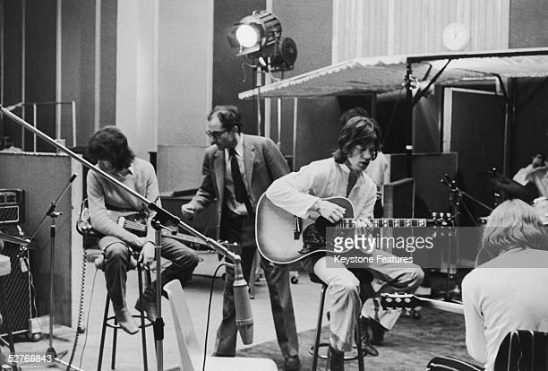 JeanLuc Godard directs Bill Wyman Mick Jagger and Brian Jones of the Rolling Stones during the shooting of the documentary film 'Sympathy For the...