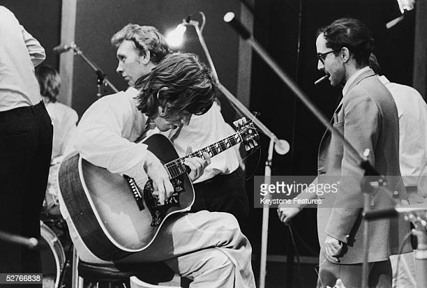 JeanLuc Godard directs Mick Jagger of the Rolling Stones during the shooting of the documentary film 'Sympathy For the Devil' 30th July 1968