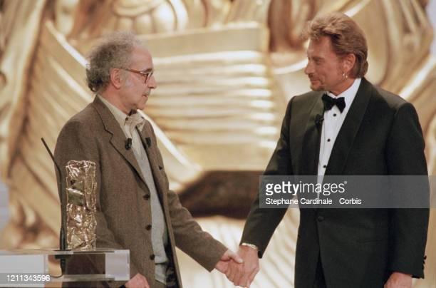 Jean-Luc Godard à la 23ème Cérémonie des Césars à Paris avec Johnny Hallyday