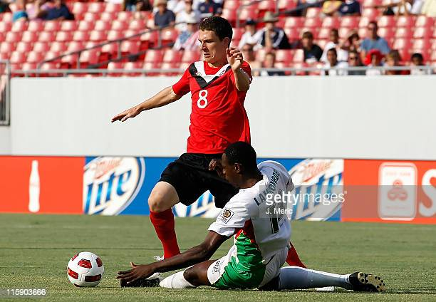 JeanLuc Lambourde of Team Guadeloupe tackles Will Johnson of Team Canada during the CONCACAF Gold Cup Match at Raymond James Stadium on June 11 2011...