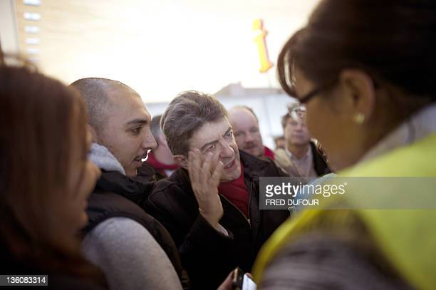 JeanLuc Melenchon French President of the Parti de Gauche and Front de Gauche candidate for the 2012 French presidential election speaks with trade...