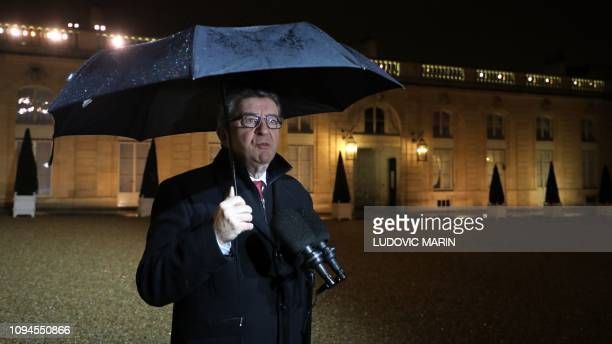 JeanLuc Melenchon head of leftist La France Insoumise party and deputy at the National Assembly addresses the press as leaves the Elysee presidential...