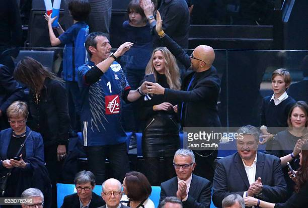 JeanLuc Reichmann greets Pascal Obispo while Julie Hantson looks on following the 25th IHF Men's World Championship 2017 Final between France and...