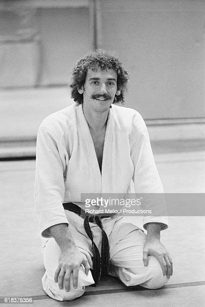 JeanLuc Rouget wears his judo uniform and black belt Rouget was the first European and the first Frenchman to become a world champion of judo