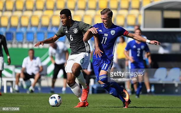 JeanManuel Mbom of Germany and Eden Karzev of Israel vie for the ball during the Under 17 four nations tournament match between U17 Germany and U17...