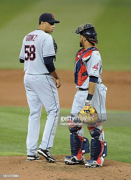 Jeanmar Gomez and Carlos Santana of the Cleveland Indians speak during the third inning against the Minnesota Twins on September 7 2012 at Target...