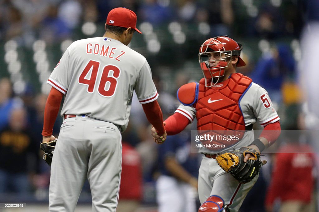 Jeanmar Gomez #46 of the Philadelphia Phillies celebrates with Carlos Ruis #51 after the 10-6 win over the Milwaukee Brewers at Miller Park on April 23, 2016 in Milwaukee, Wisconsin.
