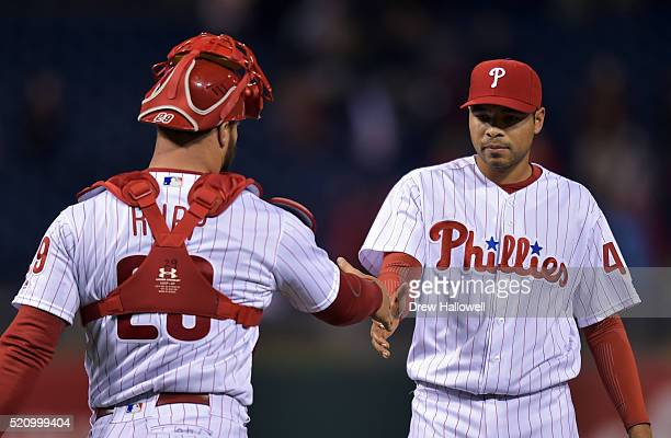 Jeanmar Gomez of the Philadelphia Phillies shakes hands with teammate Cameron Rupp after beating the San Diego Padres 21 at Citizens Bank Park on...