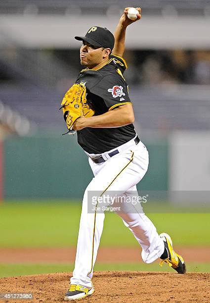 Jeanmar Gomez of the Pittsburgh Pirates pitches against the Cincinnati Reds on June 18 2014 at PNC Park in Pittsburgh Pennsylvania