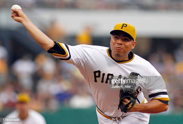 Jeanmar Gomez of the Pittsburgh Pirates pitches in the relief in the third inning against the St Louis Cardinals during the game on September 1 2013...