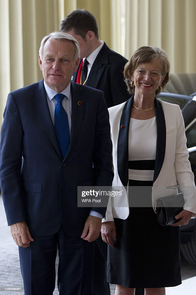 Jean-Marc Ayrault, the Prime Minister of France and his wife Brigitte Terrien arrive for a London 2012 Olympic Games reception, hosted by Britain's Queen Elizabeth II, at Buckingham Palace on July 27, 2012 in London, England.