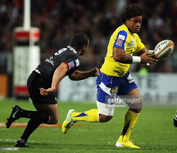 JeanMarc Doussain of Stade Toulousain Rugby challenges Sione Lauaki of ASM Clermont Auvergne during the French Top 14 Semi Final between Stade...