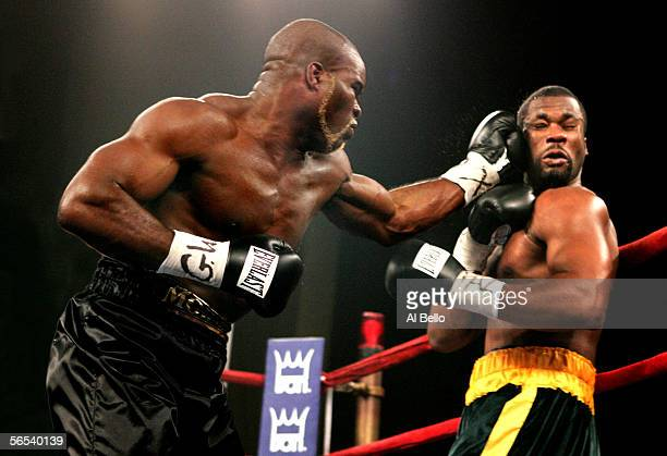 JeanMarc Mormeck connects with a left hand hook against O'Neil Bell during their World Cruiserweight Championship unification fight at Madison Square...