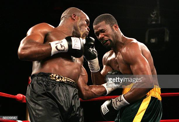 JeanMarc Mormeck connects with a left hand hook to the body of O'Neil Bell during their World Cruiserweight Championship unification fight at Madison...