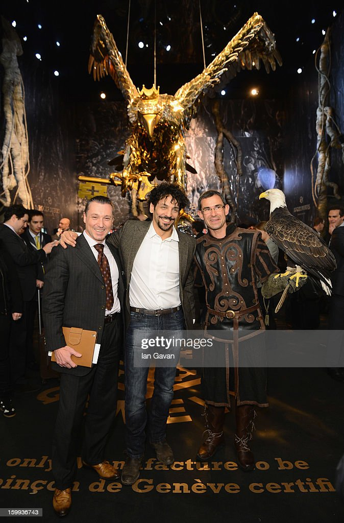 Jean-Marc Pontroue (L), CEO of Roger Dubuis and friend of the brand, Tomer Sisley (C) pose with an eagle in the booth during the 23rd Salon International de la Haute Horlogerie at the Geneva Palexpo on January 23, 2013 in Geneva, Switzerland.