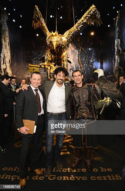 JeanMarc Pontroue CEO of Roger Dubuis and friend of the brand Tomer Sisley pose with an eagle in the booth during the 23rd Salon International de la...