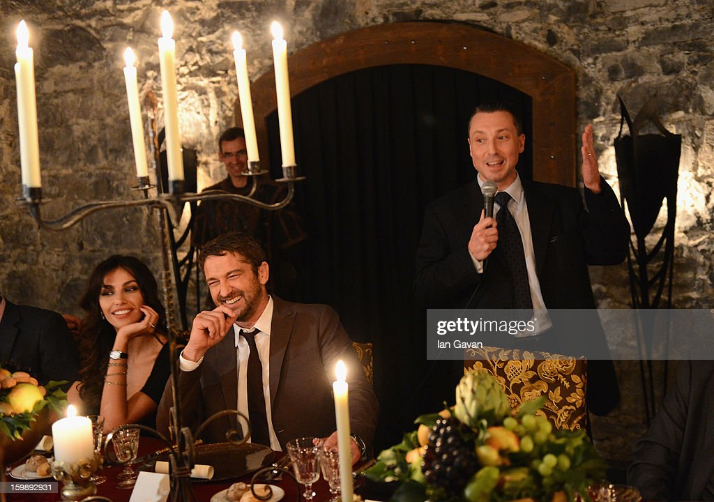 Jean-Marc Pontroue (R), CEO of Roger Dubuis talks with actor and friend of the brand Gerard Butler during the Excalibur Dinner at the 23rd Salon International de la Haute Horlogerie at Caves des Vollandes on January 21, 2013 in Geneva, Switzerland.