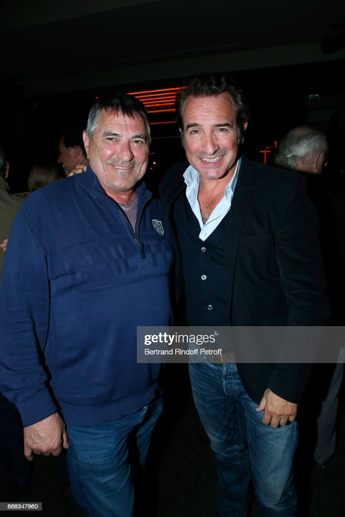 Jean-Marie Bigard and Jean Dujardin attend Claude Lelouch celebrates his 80th Birthday at Restaurant Victoria on October 30, 2017 in Paris, France.