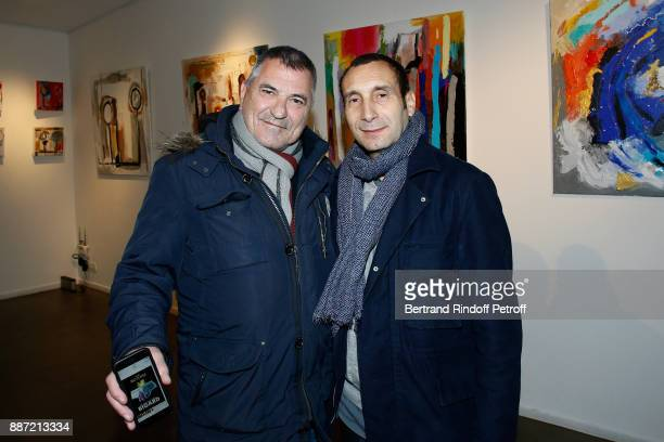 JeanMarie Bigard and Zinedine Soualem attend painter Caroline Faindt Exhibition Opening at 'L'Espace Reduit' on December 6 2017 in Paris France