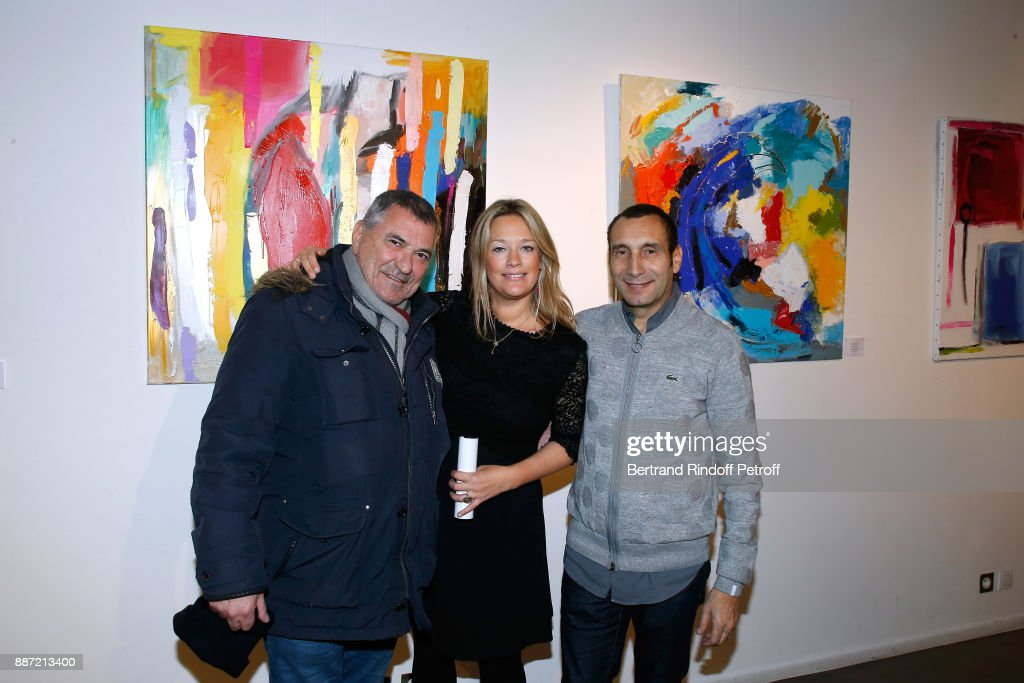 Jean-Marie Bigard, Caroline Faindt and her companion Zinedine Soualem attend painter Caroline Faindt Exhibition Opening at 'L'Espace Reduit' on December 6, 2017 in Paris, France.