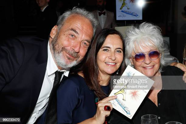 Jean-Marie Duprez; Nathalie Garcon and Catherine Lara attend Line Renaud's 90th Anniversary on July 2, 2018 in Paris, France.