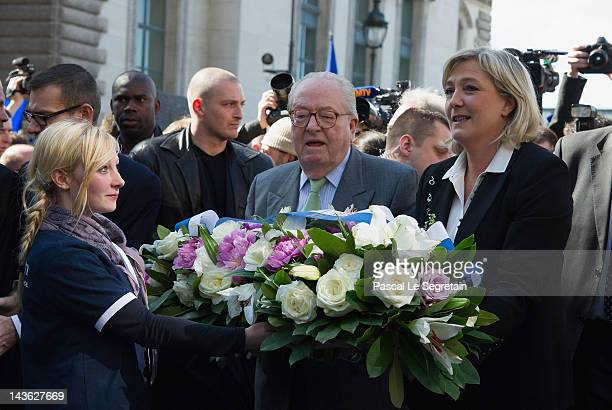 JeanMarie Le Pen and Marine Le Pen arrive to lay down flowers in front of a statue of Jeanne D'Arc as part of Far Right Party May Day demonstration...