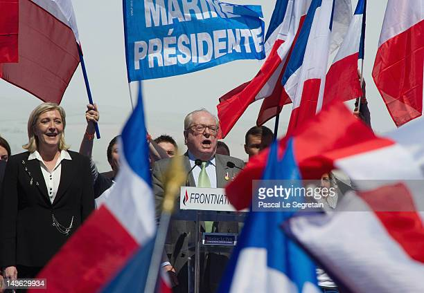 JeanMarie Le Pen and Marine Le Pen stand on stage during French National Anthem at Far Right Party May Day demonstration on May 1 2012 in Paris...