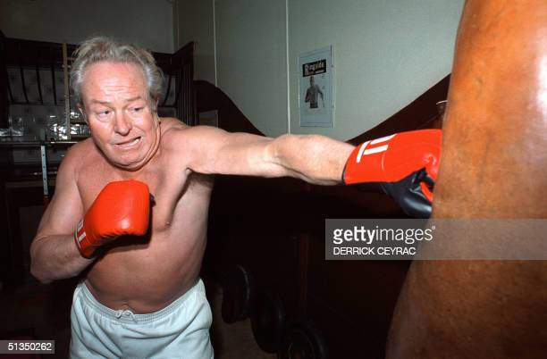 JeanMarie Le Pen France's farrighter and presidential candidate practices boxing 30 January 1988 in the training room of his residence in SaintCloud...