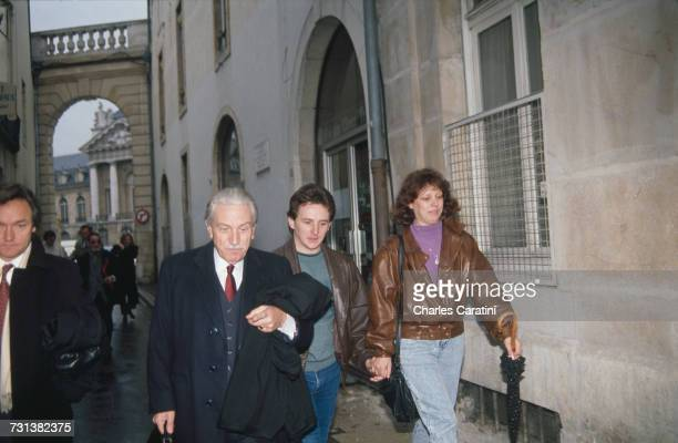 JeanMarie Villemin and his wife Christine with their lawyer HenriRené Garaud on their way to testify in the case of the murder of their four yearold...