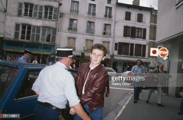 JeanMarie Villemin arrives handcuffed and in police custody at the courthouse in Lepanges Sur Vologne Vosges France where he will attend Judge...