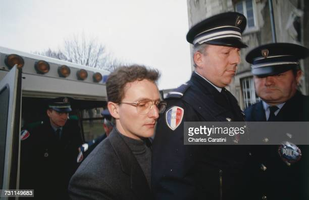 JeanMarie Villemin arrives in police custody at the courthouse in Dijon France during his trial for the murder of Bernard Laroche 17th December 1993...