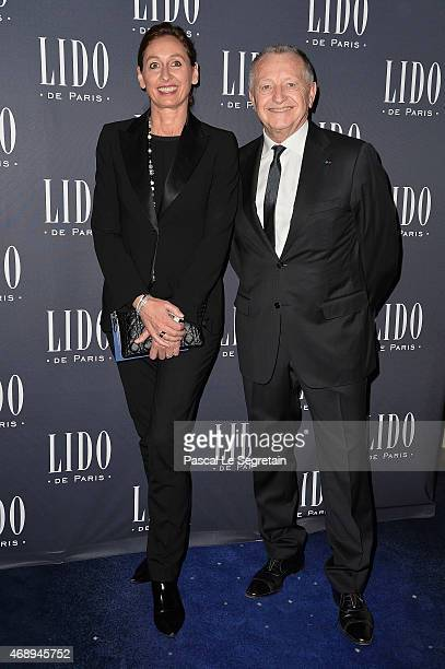 JeanMichel Aulas and guest attend the 'Paris Merveilles' Lido New Revue Opening Gala at Le Lido on April 8 2015 in Paris France