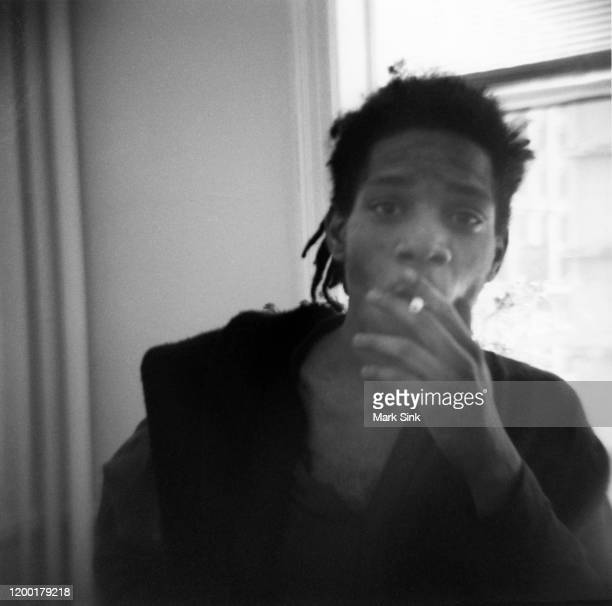 JeanMichel Basquiat smoking at the Vreg Baghoomian Gallery September 5 1988 in New York New York
